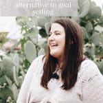 Image of a white woman with brown hair in a larger body standing in front of a big cactus. She is wearing a cream coloured top. There is a text overlay that reads: Living in alignment with your values: an alternative to goal setting. feel good eating