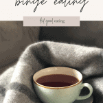 A mint green china tea cup with tea sits nestled in a blanket. This is a soothing option after binge eating. There is text overlay that reads: what to do after binge eating