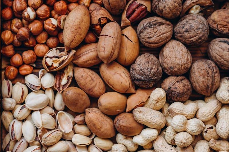 A close up of walnuts, peanuts, pistachios, hazelnuts