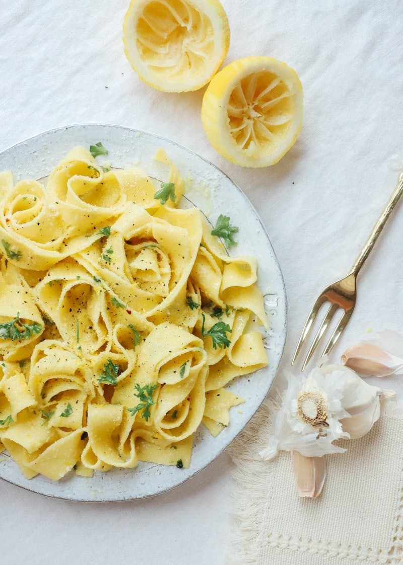 Bit plate of pappardelle pasta with some herbs, garlic and lemon.
