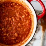 A close up of a pot of smoky baked beans