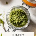 Jar of nut free pesto made with pumpkin seeds